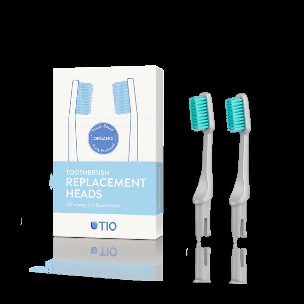 TIO - Replaceable toothbrush heads in grey / medium