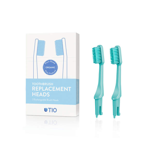 TIO - Replaceable toothbrush heads  in green / medium